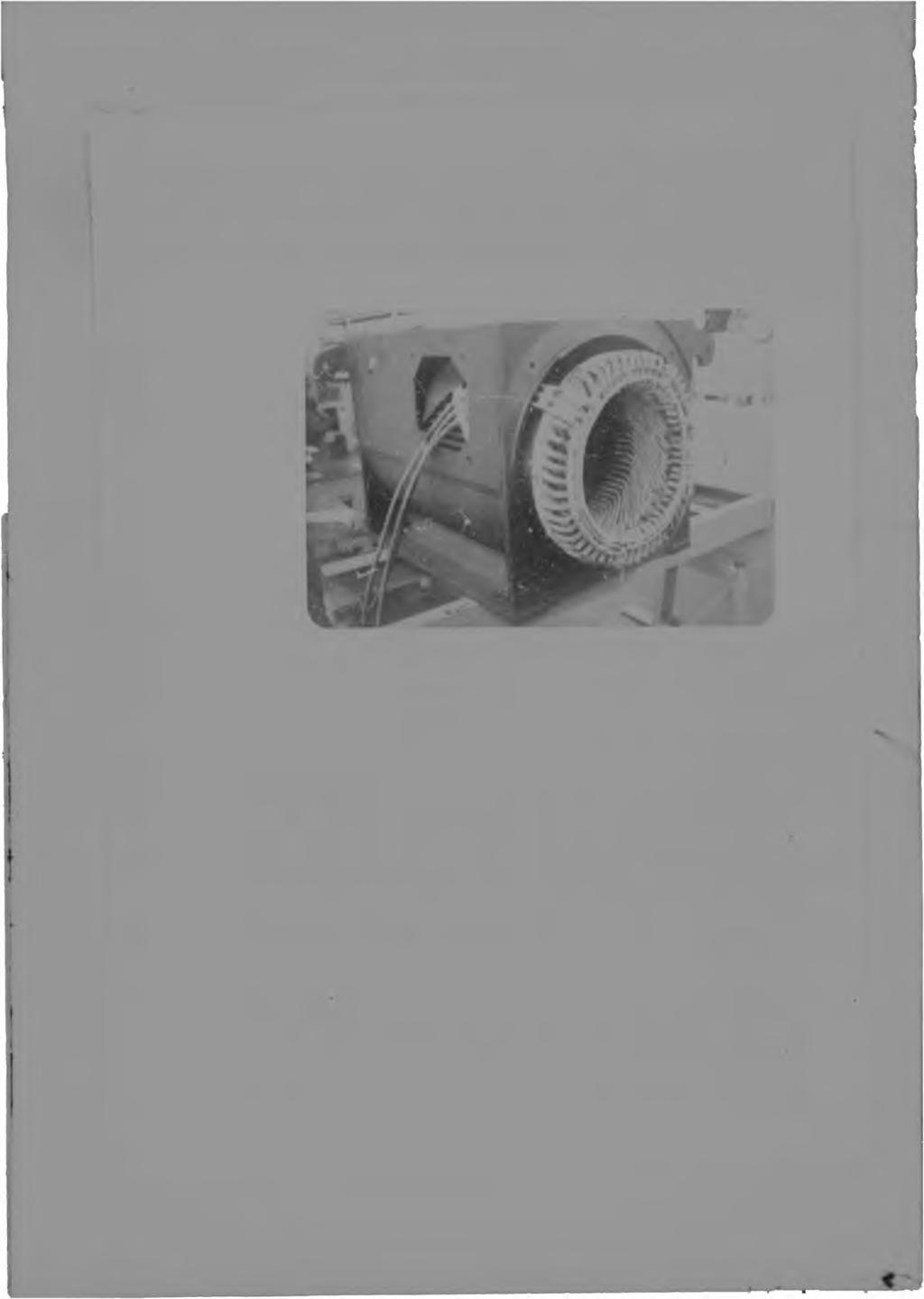 PAGE E-2 Figure E.2 - Photograph of industrial motor A showing the diamond type coils forming the primary winding. Stator winding: The stator winding (Figure E.