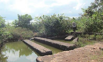 Chapter 1. Stone Heritage of Cambodia Figure 19. Ancient pits with square laterite columns.
