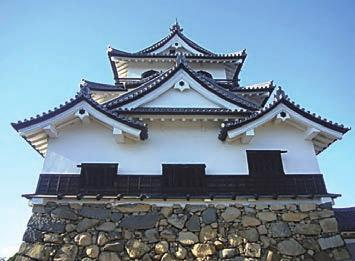 Chapter 3. Stone Heritage of Japan Figure 25. Castle tower and base stone wall of Hikone Castle (photo by H. Kato).