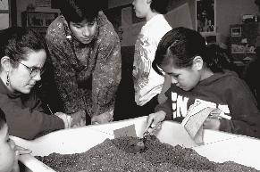 Children created their own archaeological site in the classroom in Barrow, Alaska, creating artifacts and practicing digging the site, recording the locations of their finds, and describing the