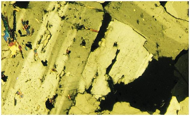 Photomicrograph of Granite Classification of Igneous Rocks Based on Mineral Composition and Texture Textures- reflect rate of cooling Phaneritic Pegmatite Aphanitic Porphyritic Phaneritic- mineral