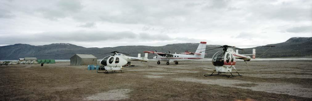Fig. 25. The GGU/GEUS base camp at Centrumsø, Kronprins Christian Land. Two small helicopters transport two-person geological field teams to new camp sites at about 6 7 day intervals.