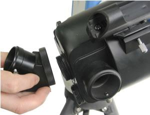 the eyepiece holder. Tighten the thumbscrews to a firm feel only. Remove the round dust cover lid from the end of telescope. Use the focus knob to bring objects into focus.