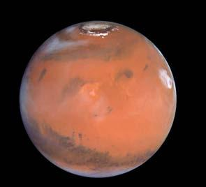The next planet is Mars. This planet has a reddish color and hardly any air. The red color is caused by rust in rocks. It is cold on Mars. Scientists have learned that Mars has ice at its poles.