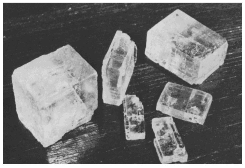 7. The photograph below shows a piece of halite that has been recently broken. 10.