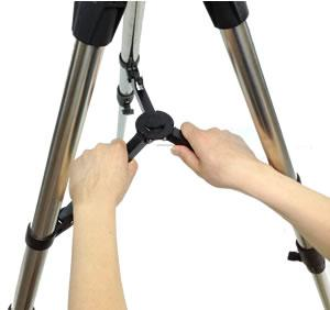 Extend tripod legs to full extension and lock knobs. 2. Stand Tripod upright. Then press down to lock center arms in place. 3.