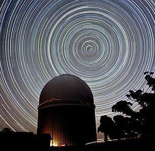 star trails from circumpolar constellations rotate counterclockwise around the north