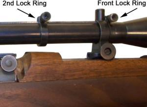 A second lock ring behind the front mount is to limit the recoil travel of the tube and to insure that the front mount stays on the rib, and the scope tube can be moved back and forth precisely.