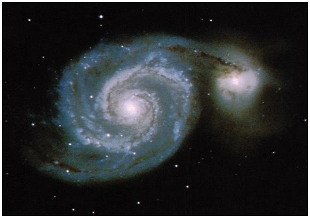 ! Galaxy may have over a trillion solar masses total! Space is big. Really big.