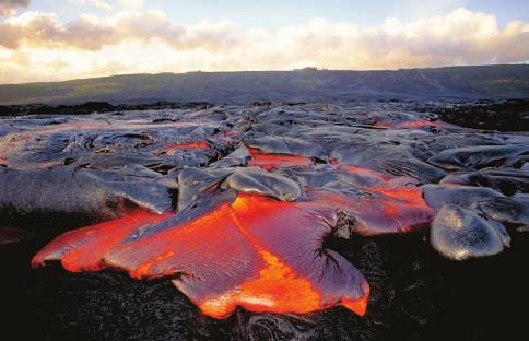 Basalt Flows Along divergent plate boundaries and in isolated hot spots, such as under the Hawaiian Islands, lava flows smoothly onto Earth s surface.