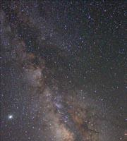 Milky Way That clumpy band of light is evidence that we live in a disk-shaped galaxy. Its pale glow is light from about 200 billion suns! Satellites Human technology!