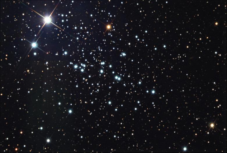 NGC 457 The Owl Cluster NGC 457 is an open star cluster in the constellation Cassiopeia. It was discovered by William Herschel in 1787, and lies over 7,900 light-years away from the Sun.