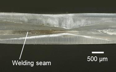 1a) generating additional friction in the near of the surface to be patterned. Besides this, the foil facilitated the flow of the molten polymer towards the sides.
