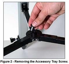 Step 3: Attach the white plastic accessory tray in place uisng the accessory