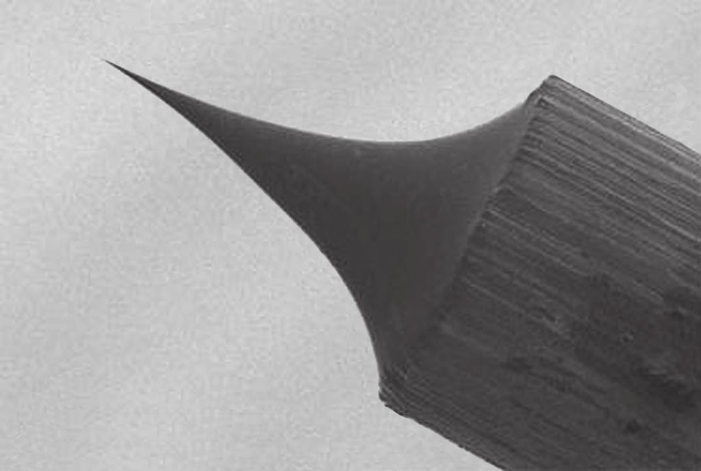 (d) Fig. 9.2 shows an image of the tip of a Scanning Tunnelling Microscope (STM). 11 tip 0.20 mm 400 pixels Fig. 9.2 The image is 400 pixels wide. Calculate the resolution of this image. resolution =.