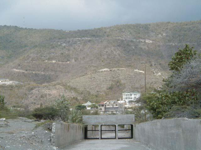 Across the Cambridge Hill through Gypsum Quarries at Bull Bay to Dallas Mountains; Pipeline is buried in this section and is impacted by