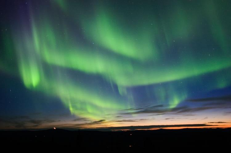 AURORA Interaction of solar wind with Earth s magnetic field.