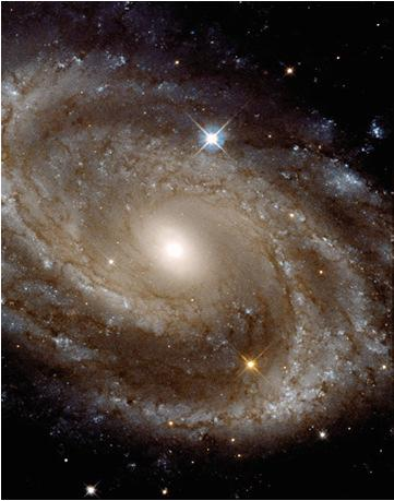 31 Spiral arms are regions of higher density gas and dust, called spiral density waves. The compression of this gas triggers the formation of new stars.