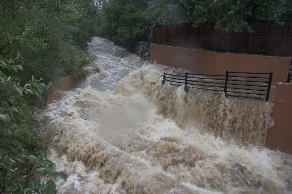 Bear Creek in south Boulder normally a placid thoroughfare is engulfed by flood waters on Thursday afternoon, September
