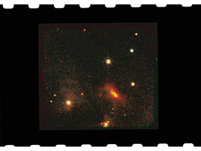 Still enshrouded in opaque cocoons of dust => barely visible to normal telescopes, but bright in the