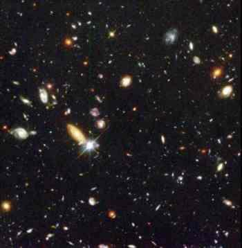 simulations of the early universe and by observations of galaxies at great distances that show these galaxies are smaller