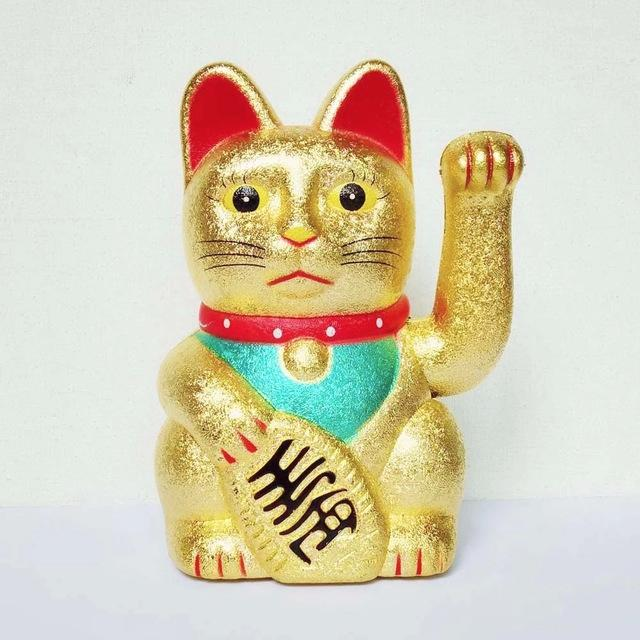b) Another engineer from the marketing department wants to sell the component as a replacement for the well-known Maneki-neko ( ) (Figure 2), so he wants it to wave with a given frequency ω wave (0,